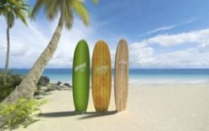 Voyage à Hawaii - Plage avec planche de surf